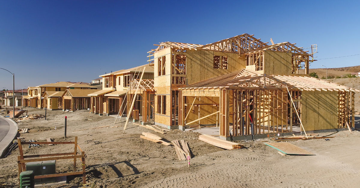 Homes being built at construction site in new housing community. Booming Housing Market.