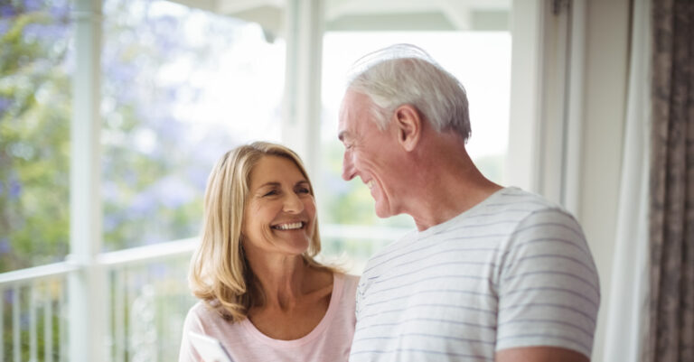 Happy Senior couple outside on deck