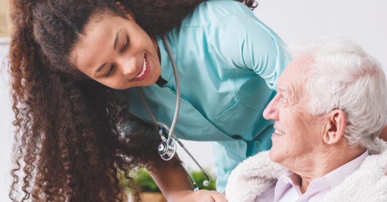 Woman taking care of senior in nursing home