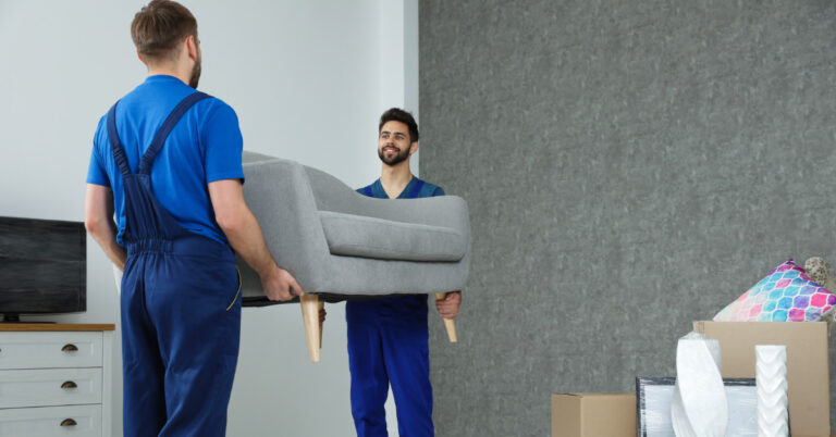 2 men moving a couch - working for moving companies