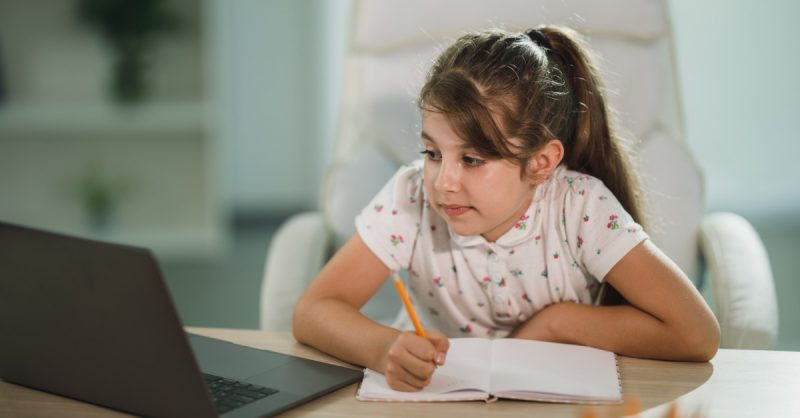 Child taking distance learning courses
